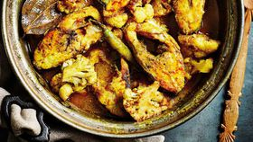 Anjum Anand's one-pan Bengali sea bream with cauliflower