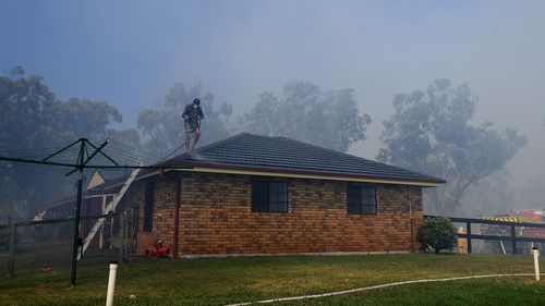 The Campvale bushfire burning north of Newcastle, NSW has been downgraded to an 'Advice' level.