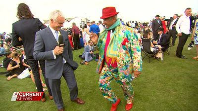 Martin learns some dance moves from this racegoer.