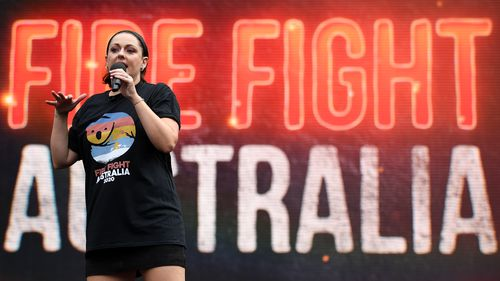 Celeste Barber speaks during the Fire Fight Australia bushfire relief concert at ANZ Stadium in Sydney, Sunday, February 16, 2020. (AAP Image/Joel Carrett)