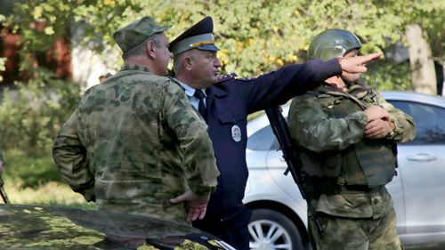 Military and police near the site of an attack at a vocational school in Crimea, Russia.