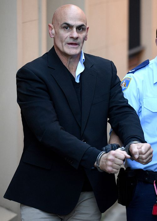 Vinzent Tarantino is led to a waiting Corrective Services transport van at the NSW Supreme Court in Sydney, on October 17, 2019.