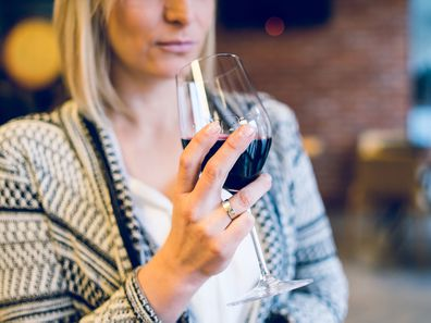 Woman drinking wine alone