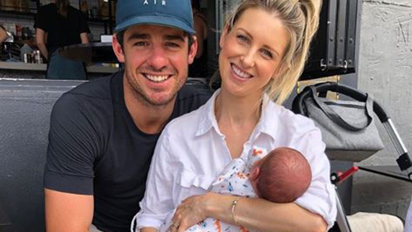 Moises Henriques with wife Krista and son Archie.