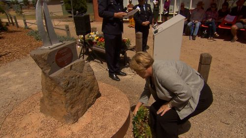 Emergency Services Minster Lisa Neville paying her respects to the victims of the 69' blaze.