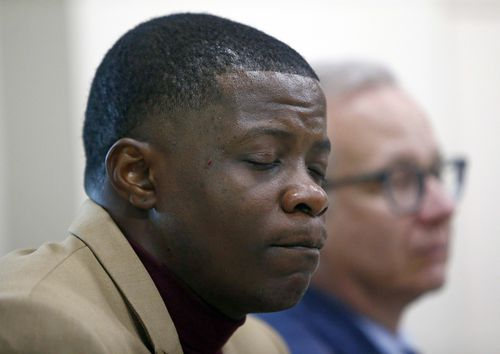 Shaw holds back tears during a press conference on the shooting. (AP)
