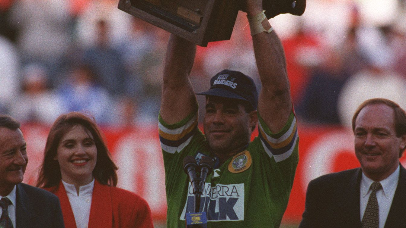 Mal Meninga holds up the 1994 Winfield Cup trophy in his Canberra Milk jersey.