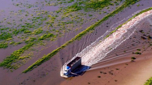 Mr Shepherd lost all his crops in the deluge, and launched a fundraising calendar with his aerial shots, including an image of a farm truck battling through floodwater.