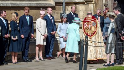 Members of Britain's Royal family watch as Britain's Queen Elizabeth II arrives to attend the Easter Mattins Service at St. George's Chapel, at Windsor Castle in England Sunday, April 21, 2019