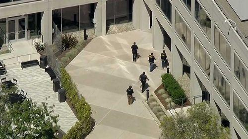 Police walk into the YouTube headquarters in San Bruno, California. (ABC America)