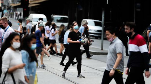 Despite relaxing mask rules outside yesterday the government has made them compulsory outdoors again. (Getty)