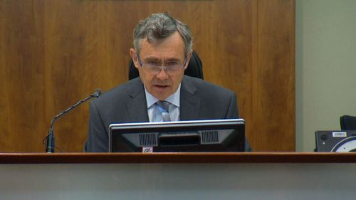 Magistrate Tony Parsons conducts hearings to determine whether one applicant will be jailed and one will be admitted.