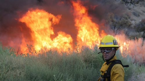 An estimated 2,000 personnel have been battling the blaze. (AAP)