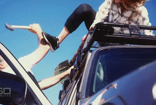 In a reconstruction, an actor playing Lena on top of the 4WD kicks out at Heinze's arm wielding a hammer. 60 Minutes)