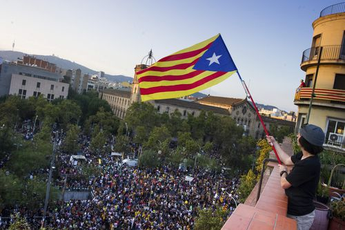 Thousands of people demonstrate at University square, in downtown Barcelona. (AAP)