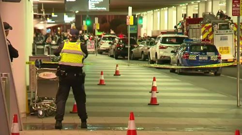 Two adult men and an eight-year-old boy were hit by the car when the driver mounted the kerb at the airport's drop-off zone. Picture: 9NEWS.