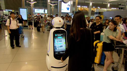 Robots are being used as guides around train stations.
