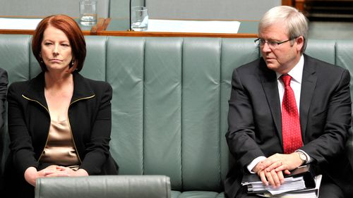 A 2010 file photo of then Prime Minister Julia Gillard and foreign minister Kevin Rudd during a House of Representatives division in Canberra.