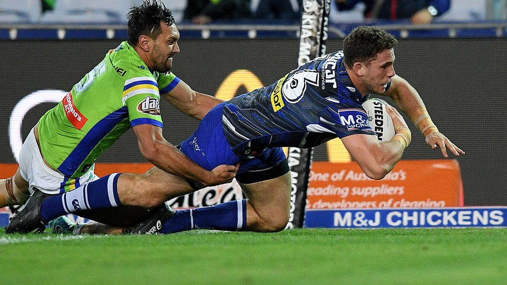 Dogs fight to gutsy win over Canberra