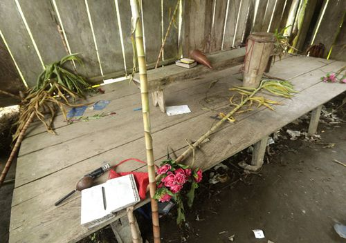 Bibles, flowers, a drum and a microphone are seen inside the improvised temple.