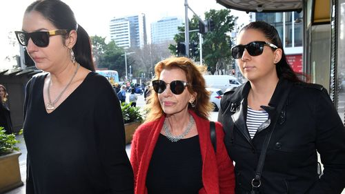 Rosa Miano (centre), wife of John Jarratt, arrives at the Downing Centre Local Court in Sydney.