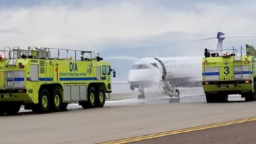 The United plane landed at Denver Airport with one of its engines on fire. (Twitter / Raiyan Syed)