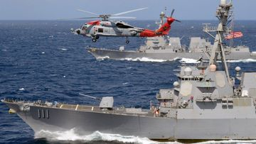 The guided-missile destroyers USS Spruance and USS Preble.