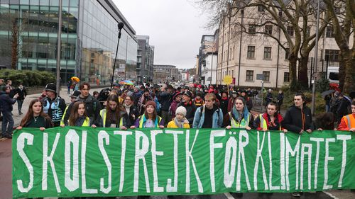 Greta Thunberg (centre) takes part in the Bristol Youth Strike 4 Climate protest at College Green in Bristol.