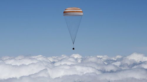 The capsule carrying the space travellers descends back to Earth. (AAP)