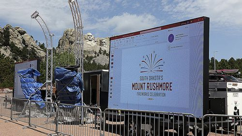 Mount Rushmore fireworks event staff test the video displays for Level 2 ticket holders across Highway 244 from the parking ramps at Mount Rushmore National Memorial, S.D., Thursday, July 2, 2020