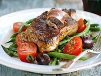 Steaks with green bean, tomato and olive salad