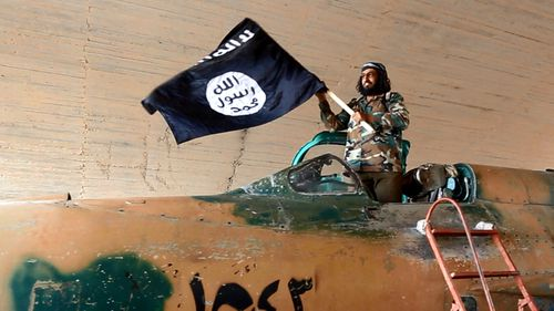 Islamic State fighter waving their flag