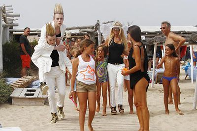 John and Edward Grimes, of Jedward, get ready to work on their tans with Tara Reid in Saint Tropez.