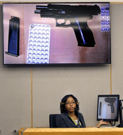Dallas Police crime scene analyst Robyn Carr answers questions on the witness stand about Amber Guyger's 9mm handgun