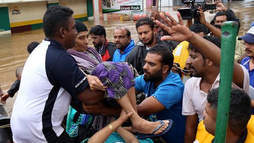 Thousands of people stranded on their rooftops have been evacuated after unprecedented flooding in the southern Indian state of Kerala killed more than 320 people over nine days.