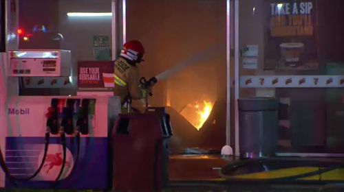 The blaze, which started in the laundromat, quickly spread to the next door petrol station and came dangerously close to gas and petrol tanks. Picture: 9NEWS.