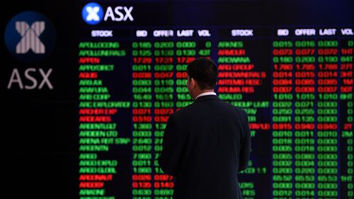 The indicator board at the Australian Securities Exchange (ASX) is seen in Sydney yesterday.