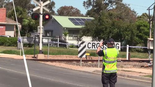 A teenage boy is fighting for life after a car he was travelling in collided with a train at a level crossing in Victoria's east.