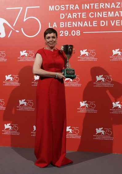Actress Olivia Colman holds the Coppa Volpi Best Actress award for 'The Favourite' at the awards photo call of the 75th edition of the Venice Film Festival in Venice, Italy, Saturday, Sept. 8, 2018