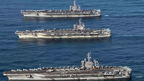 The the aircraft carriers USS Theodore Roosevelt, USS Ronald Reagan and USS Nimitz'. (Photo: US Navy).