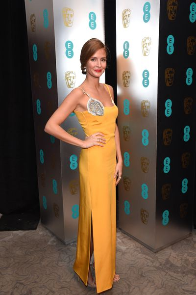 Millie Mackintosh in a Sarah Baadarani sunshine yellow strapless gown with jewel detail at the shoulder.
