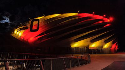 Nagyardei Stadium is illuminated with the Belgian national colours in Debrecen, 226 kms east of Budapest, Hungary. (AAP)