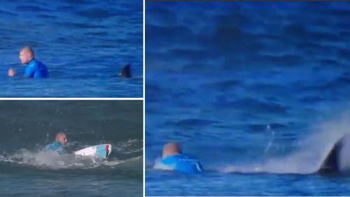 Mick Fanning battles the shark.