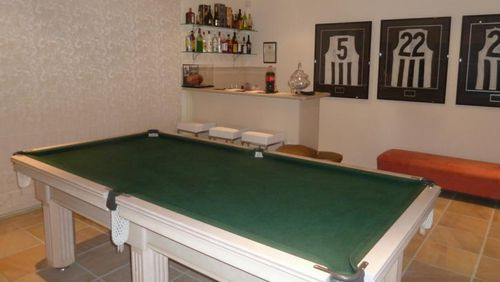 The home has a billiard room with bar.