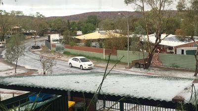<p>Hail on Alice Springs roofs and roads. </p> <p>(Jade Kudrenko)</p>