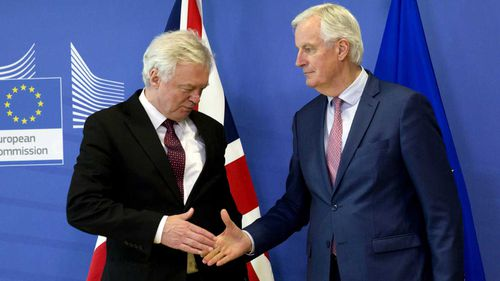 European Union chief Brexit negotiator Michel Barnier, right, reaches out to shake hands with British Secretary of State for Exiting the European Union David Davis. (AAP)