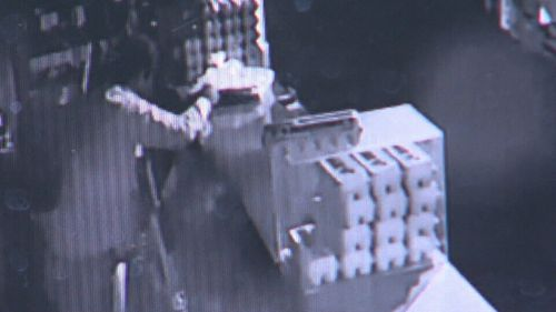 CCTV shows the man helping himself to trays of meat. (9NEWS)
