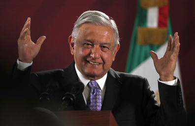 Mexican President Andres Manuel Lopez Obrador smiles during his daily morning news conference at the National Palace in Mexico City.