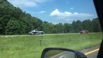 9RAW: US trooper filmed racing down wrong side of freeway