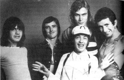 Malcolm Young, Phil Rudd, Paul Matters, Angus Young and Bon Scott.